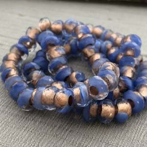 6x9mm Large Hole Roller Bead Dark Periwinkle with Copper Lining