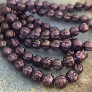 6mm Melon Violet with a Golden Luster